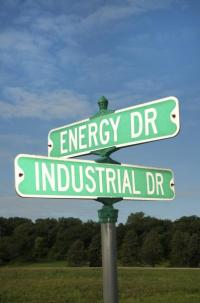 street signs at crossroads of energy and industrial drives